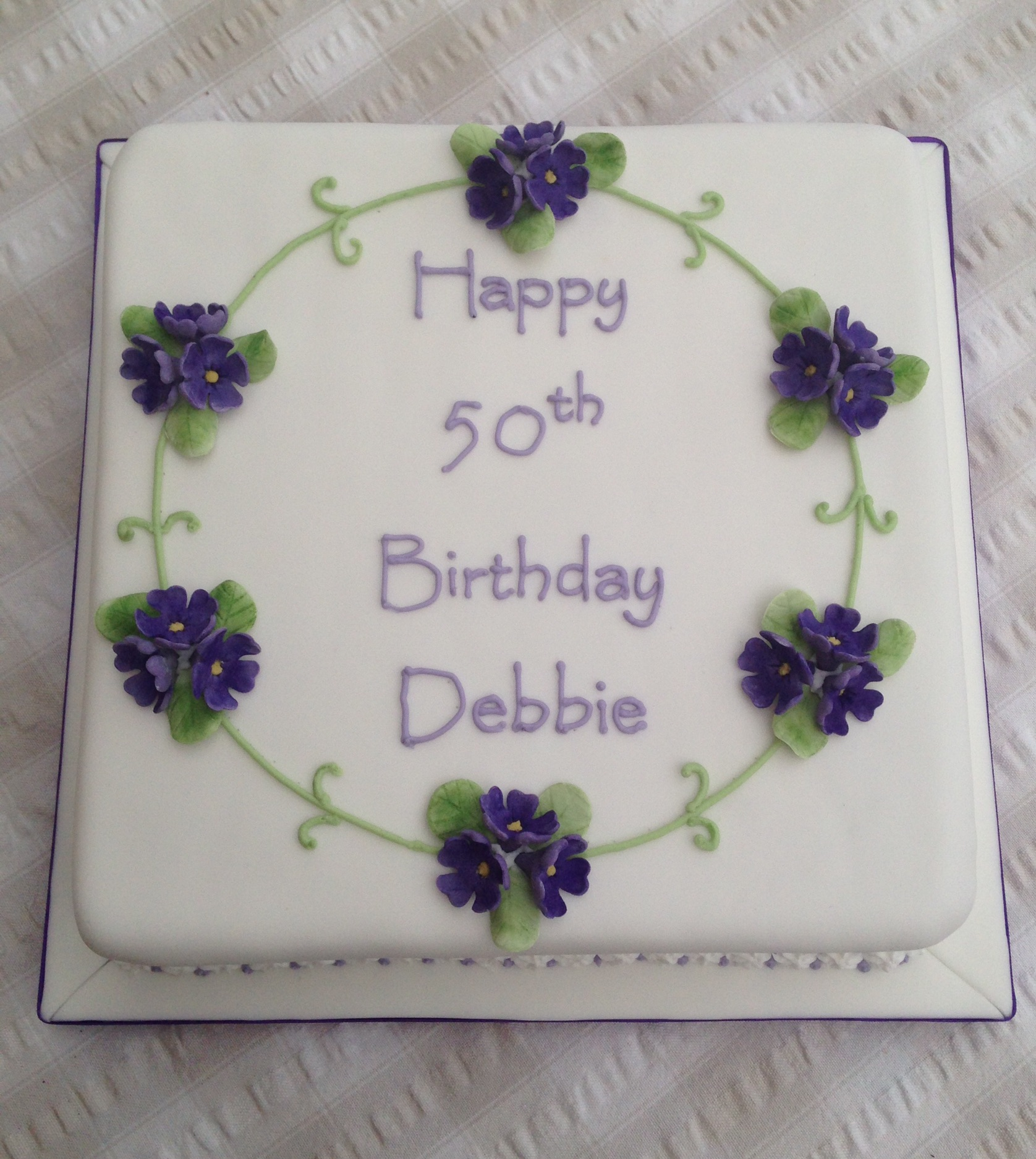 Magnificent 50Th Birthday Cake With Purple Flowers Cakes On Sea Funny Birthday Cards Online Elaedamsfinfo
